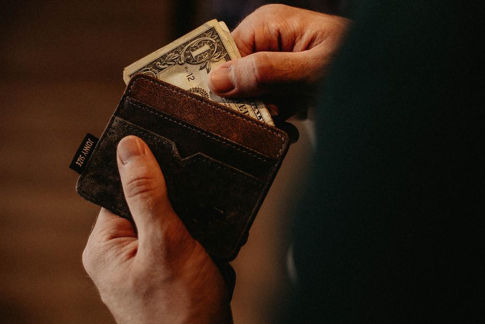 Wallet full of dollar notes