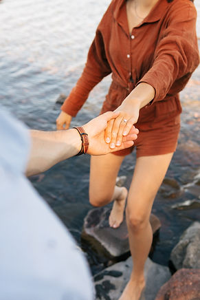 Photo of man and woman holding hands - Image by Brandon Cormier