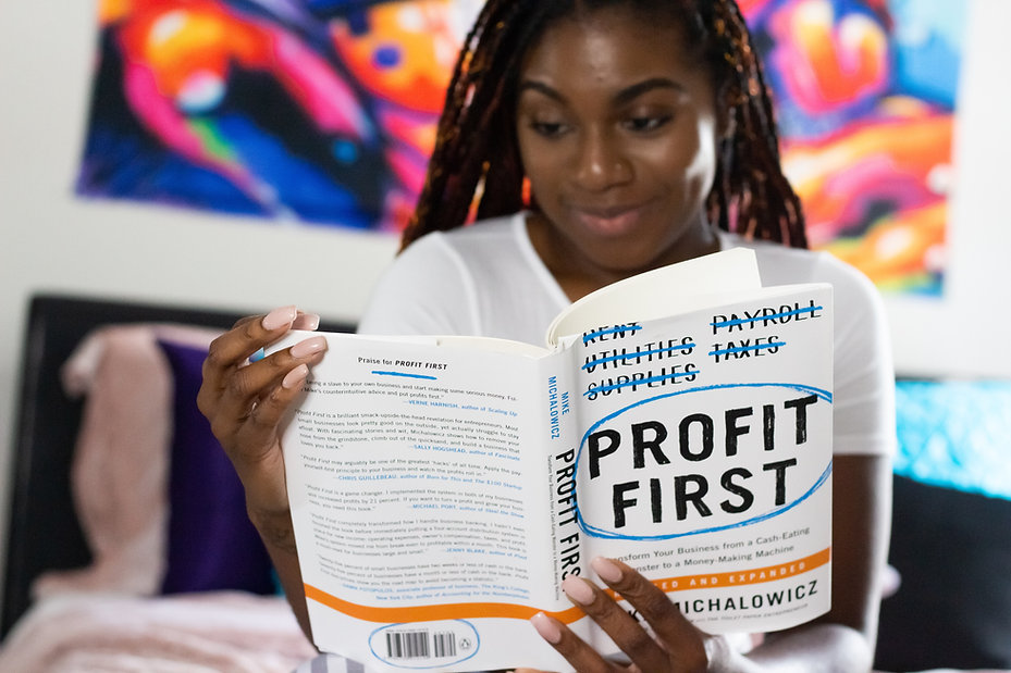 A women reading a book on Profit