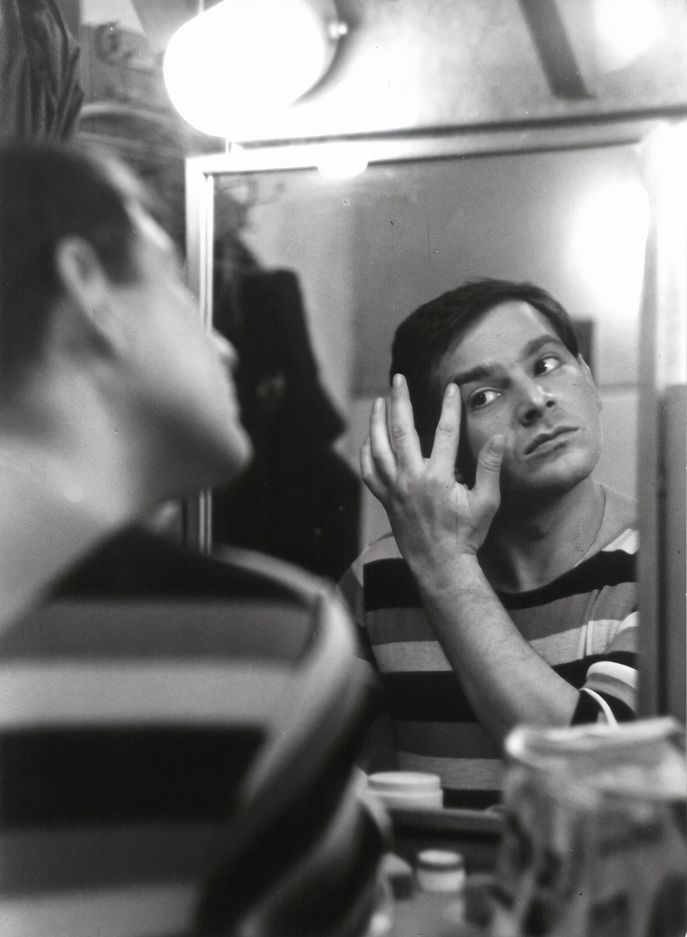 Man looking at the mirror black and white